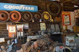 Interior Of A Route 66 Garage Displaying Good Year Vintage Sign