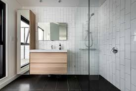 modern bullnose tiles with vertical subway tiles bathroom