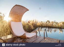 100 Tierra Atacama Chair By Swimming Pool At Hotel In San Pedro