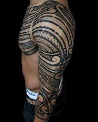 Man With Shoulder And Half Sleeve Tribal Tattoo Design