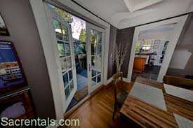 Side Garden Dining Deck Opening Off The Formal Room Through French Doors