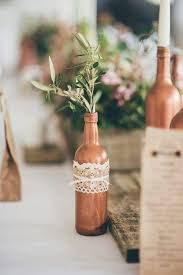 Rustic Copper Sprayed Wine Bottles For Table Decor Made Feminine With Sime Lace And Olive