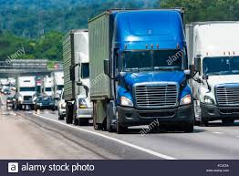 A Long Steady Line Of Truck Traffic On A Busy Interstate. Image Shot ...