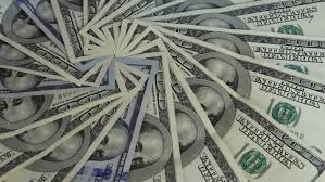 Background With 100 US Dollar Bills Rotate Seamless Looping
