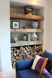 Reclaimed Wood Shelves Next To Fireplace