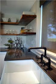 Rustic Black Finished Faucet For Cozy Farmhouse Style Kitchen With Wooden Shelves And White Ceramic Sink
