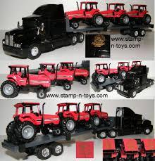 100 Ertl Trucks T725 Kenworth T600 WFlatbed And Load Of Case IH Magnums No