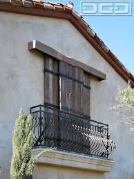 Reclaimed Barn Wood Sliding Shutters In A Rustic Tuscan Style
