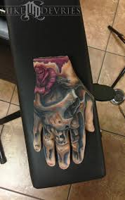 Real Tattoo On Fake Hand By Mike DeVries TattooNOW