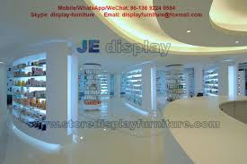 Hot Selling Pharmacy Store Display Furniture In White Color Wall Storage Cabinet With Drawers And Glass Shelves