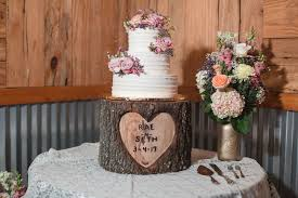 Rustic Country Wedding Cake With Buttercream On A Tree Trunk Wooden Stand