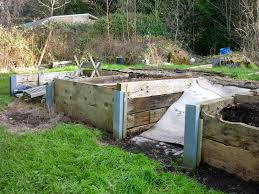 Some Rather Brilliantly Made Compost Bins At My Friends Fathers Garden Using Railway Sleepers And Galvanised Steels Concreted In To Hold Them Place