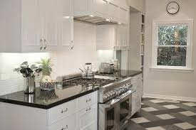 Elegant White Cabinet With Black Countertop And Window Treatment