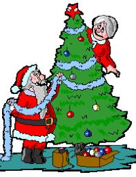 Santa Decorating The Tree