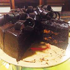 Soft And Moist Chocolate Cake Enveloped In Icing With Layers Of Not Too Sweet Yema Caramel Filling That Makes The More Enjoyable