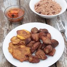 cuisine avec du riz griot haitien avec riz et sauce haitian cuisine
