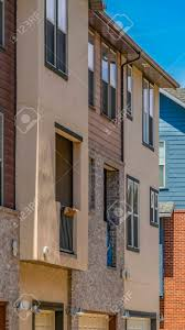 100 Brick Walls In Homes Vertical Exterior Of Townhouses Against Bright Blue Sky On A