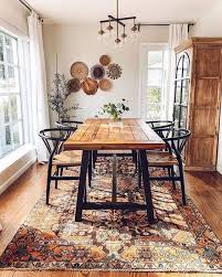 a modern bohemian style dining room adorned with