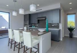 Dark Grey Cabinets Contemporary Kitchen With White Island And Gray Porcelain Tile Flooring