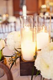 White Tulip Arrangements In Coordinating Metallic Containers With A Lush All Floral Arrangement Rustic Wooden Box