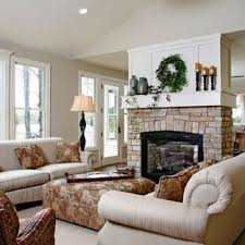 beautiful living room with fireplace in middle how to decorate a