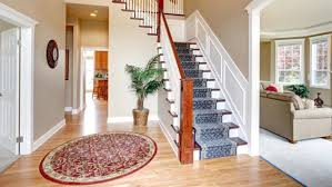Beautiful Interior Of Hardwood Floor Leading Up To Staircase