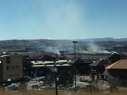 Brush fire breaks out near Castle Rock hospital outlet mall