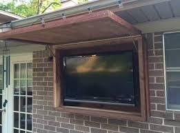 Outdoor TV cabinet made of rough cedar lumber outdoortvcabinet