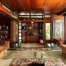 Open Concept Sunken Living Room Surrounded By Indoor Pool