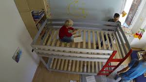 assembly of ikea mydal bunkbed hack with custom climbing wall