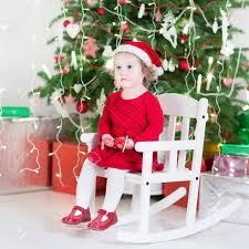 Cute Toddler Girl In A Red Dress And Santa Hat Sitting In A White.. Amazoncom Kids Teddy Bear Wooden Rocking Chair Red Delta Children Cars Lightning Mcqueen Mmax 3 In 1 Korakids Red Portable Toddler Rocker For New Personalized Tractor Childrens Pied Piper Toddler Great Little Trading Co Fisher Price Baby Chair Horse Baby On Clearance 23 X 14 22 Rideon Toys Whandle Plush Rideon Deer Gift Little Cute Haired Boy Sits Astride A Rocking Horse Pads Cushions Chairs Carousel Adirondack Starla Child Cotton
