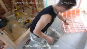 radiant heated bathroom floor installation how to do it from a