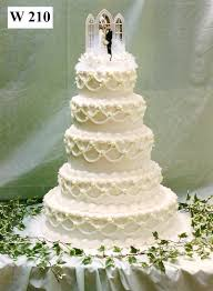 Traditional buttercream wedding cake with bride and groom topper