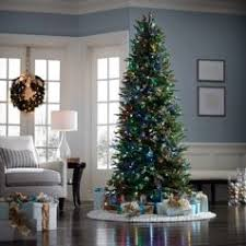 A Tall Thin Christmas Tree In Living Room