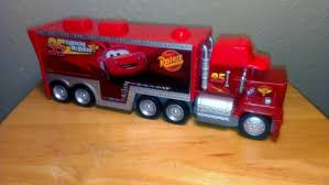 100 Cars 2 Mack Truck DISNEY PIXAR CARS MACK TRUCK STORE GO WITH 3 SQUINKIES