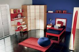 Appealing Kids Bedroom With Blue Wall Paint Simle Corner Cabinet And Desk Red Chair Bed Edge Dark Floor Tiles Image
