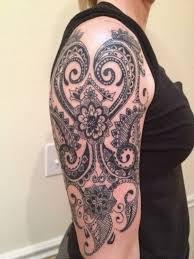 Half Sleeve Tribal Tattoo For Women