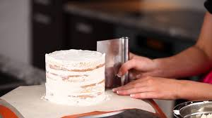 How To Layer And Frost A Cake With Perfectly Smooth Sides