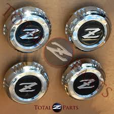TotalZParts: Datsun 280zx 4-Spoke Wheel Center Caps *NOS*