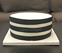 sweet delights a simple black and white striped cake
