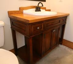 Hand Crafted Custom Wood Bath Vanity With Reclaimed Sink by MOSS