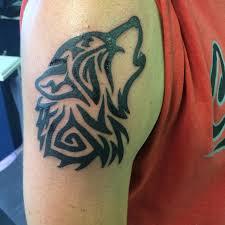 Tribal Howling Wolf Tattoo Design