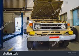 Used Pick Truck Mechanic Shop Hood Stock Photo (Edit Now) 1020302236 ... Used Pick Up Trucks Awesome Toyota Dealership New Cars And Pickup Denver Lovely 4x4 For Sale In Co By Owner Md Realistic Craigslist St Best Pickup Trucks 2019 Auto Express Truckss Miami Chevy For Near Me C10 Truck Find The Tips Buying A Tnsell 5 Work England Bestride Now Is Time To Buy Or Suv 1962 Ford Stock 13009 Sale Near San Ramon Fullsize From 2014 Carfax Or Renting A Car Dealer Giving