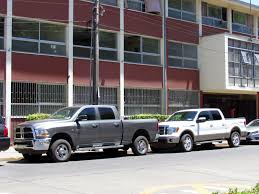 File:Dodge Ram 2500 & Ford F150 (13386152213).jpg - Wikimedia Commons 2015 Ford F150 Towing Test Vs Ram 1500 Chevy Silverado Youtube 2018 Ram Vs Dave Warren Chrysler Dodge Jeep Amazingly Stiff Frame Put The F350 To A Shame Watch This Ultimate Test Of Most Fierce Pick Up Trucks 2019 Youtube Thrghout Best 2011 Ford Gm Diesel Truck Shootout Power Is The 2016 Nissan Titan Xd Capable Enough To Seriously Compete With 2500 Vs F250 Which For You Chris Myers Fordfvs2017dodgeram1500comparison Jokes Lovely Autostrach 2013 Laramie Longhorn