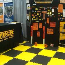 learn whether foam or plastic trade show tiles are best