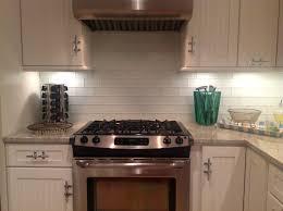 subway tile green glass kitchen backsplash white cabinets