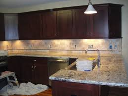 Kitchen Backsplash Ideas With Dark Wood Cabinets by Simple Kitchen Ideas With Brown Mosaic Tumbled Limestone Tile