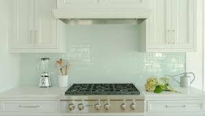 white glass backsplash kitchen cabinets with blue tile 17