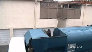 Garbage Truck Lifting Trash Cans In Orange County California At The ...