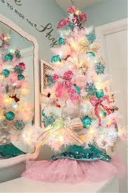 white tree with multicolor lights lights